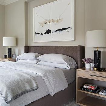 Gray Upholstered Bed With Brass And Marble Bedside Tables