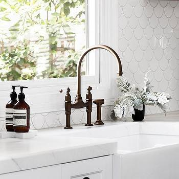 White Kitchen With White Fish Scale Tile Backsplash