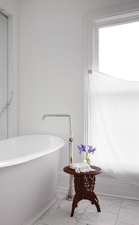 roll top bathtub with floor mount tub filler