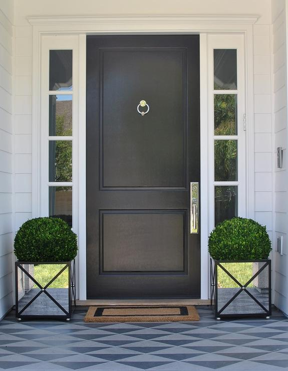 Black Front Door With Mirrored Planters Transitional Home Exterior
