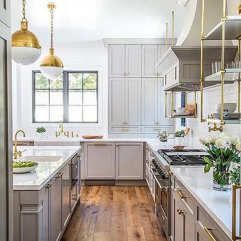 White And Gray Kitchen With Gold Pendants Transitional