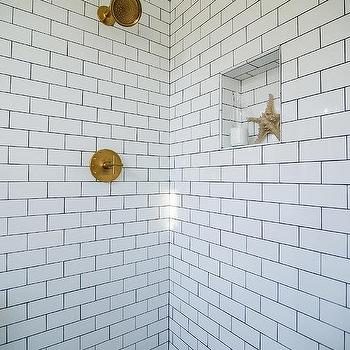 shower with white subway tiles and gray marble basketweave floor tiles