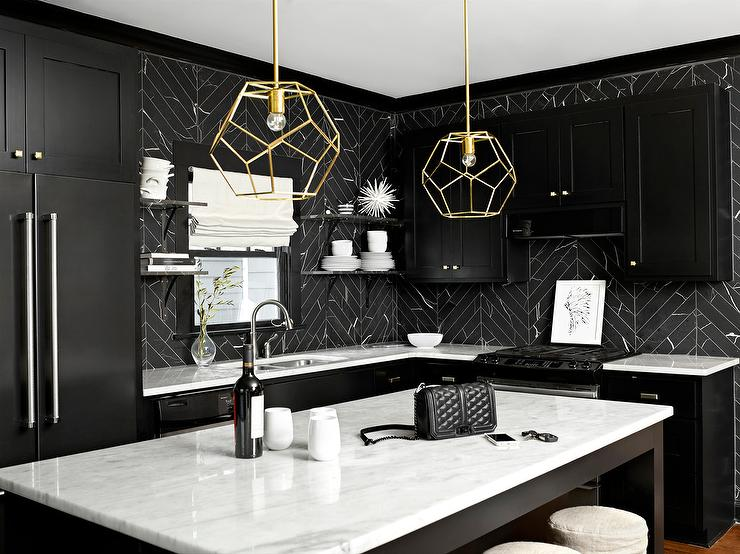 Black And White Kitchen Features Black Shaker Cabinets Paired With White  Marble Countertops And A Black Marble Herringbone Tile Backsplash.