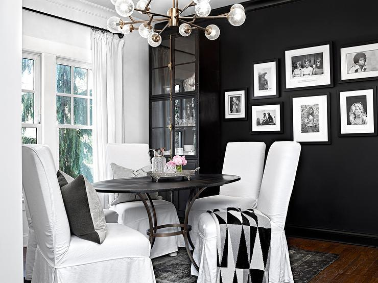 white and black dining room with black cremone bolt china cabinet