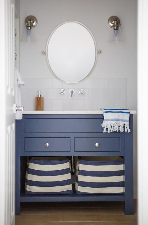 Blue And White Cottage Bathroom Features A Washstand Finished With Polished Nickel Knobs Shelves Holding Striped Canvas Bins Topped
