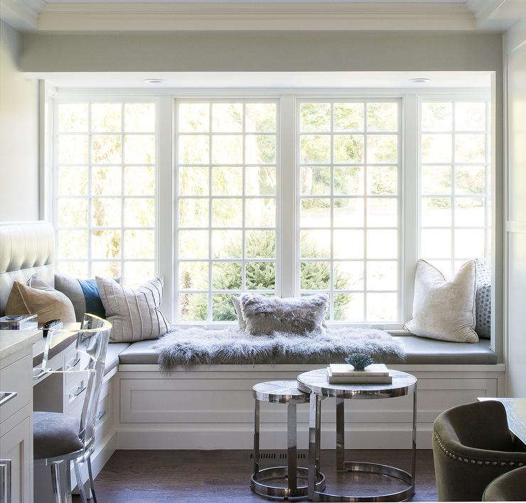 Stunning Dining Room Boasts A White L Shaped Window Seat Topped With A Gray  Cushion Accented With A Gray Sheepskin Throw And An Assortment Of Pillows.