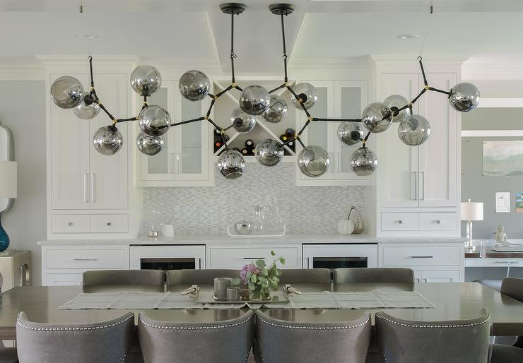 Well Appointed Contemporary Gray And White Dining Room Features Dark Stained Lacquered Table Seating Nailhead Chairs Positioned On A