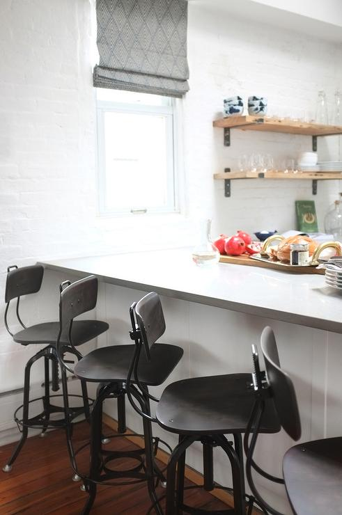 White Kitchen Peninsula With Black VIntage Architect Stools