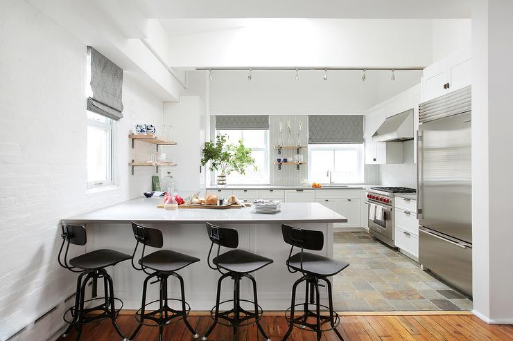 Kitchen Island Against Wall gray shiplap center island with vintage architects stools