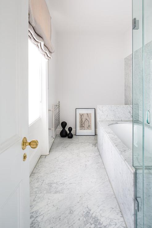 Long Bathroom With Marble Clad Bathtub Transitional