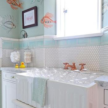 Penny tiles with copper border for Orange and blue bathroom designs