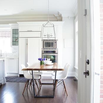 Iron And Wood Dining Table With White Molded Plastic Chairs