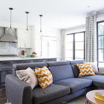 Modern Dark Gray Sectional With Orange Chevron Pillows