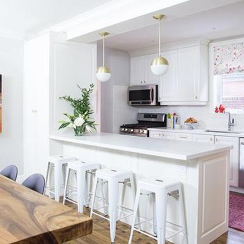 Elegant White And Pink KItchen Design With Gold Pendant Lights