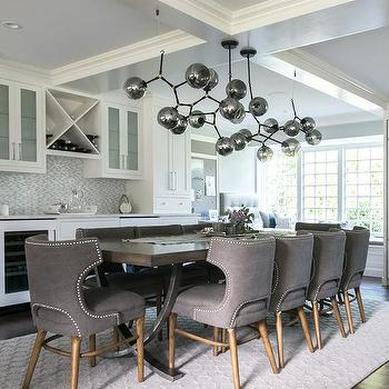 X Based Dining Table With Gray Nailhead Chairs
