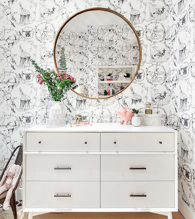 Gold Convex Mirror Above White And Gray Nursery Dresser