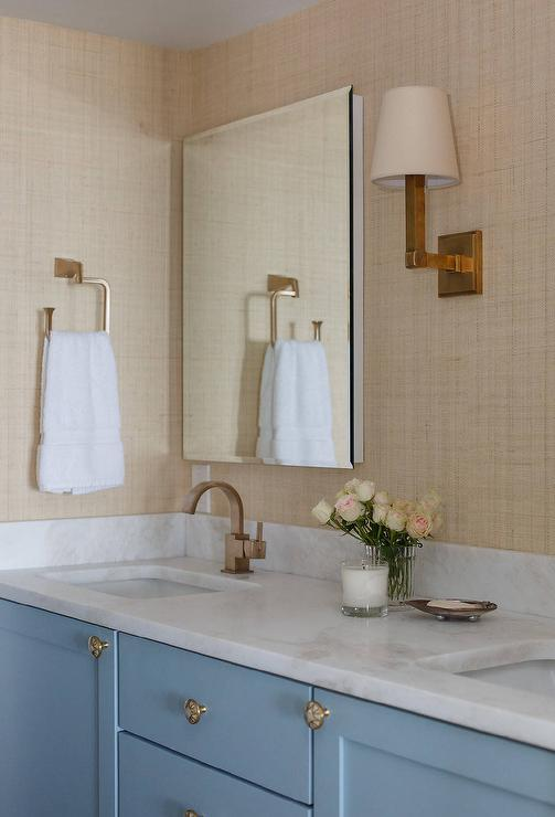 blue bath vanity cabinets with sand raffia wallpaper