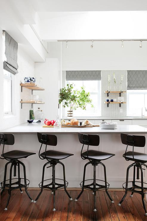 Black vintage architectu0027s stools sit in front of a white peninsula accented with a gray quartz countertop located beneath a window covered with a gray ... & White and Gray KItchen with Vintage Architect Stool - Transitional ... islam-shia.org