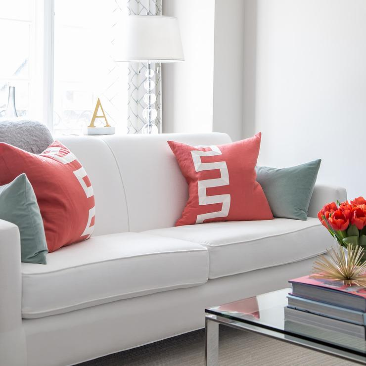 White Roll Arm Sofa With Red Greek Key Pillows
