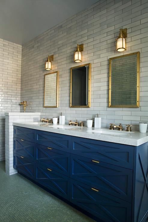 blue sink vanity with three sinks and brass faucets contemporary