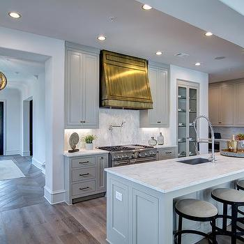 Charmant Light Gray Kitchen Cabinets With Polished Brass Range Vent Hood