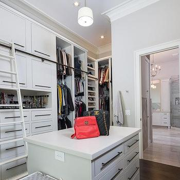 White Walk In Closet With Triple Stacked Clothes Rails