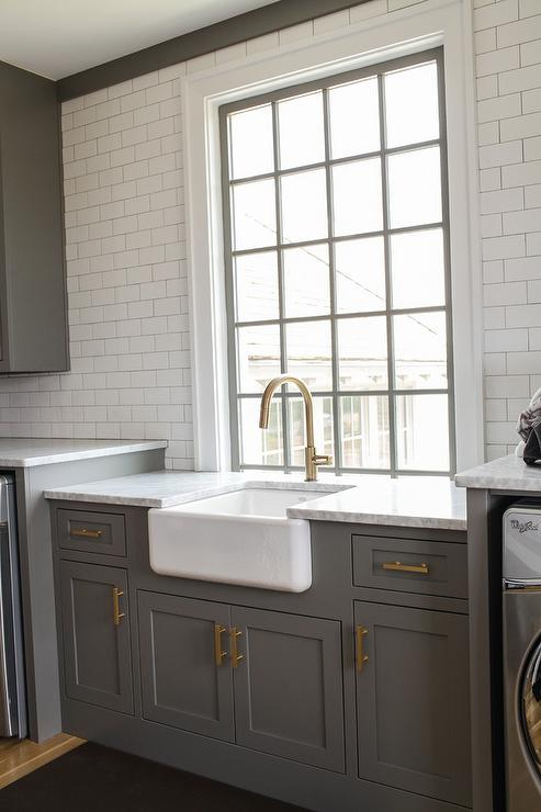 Stainless Steel Laundry Room Sink With Gold Gooseneck