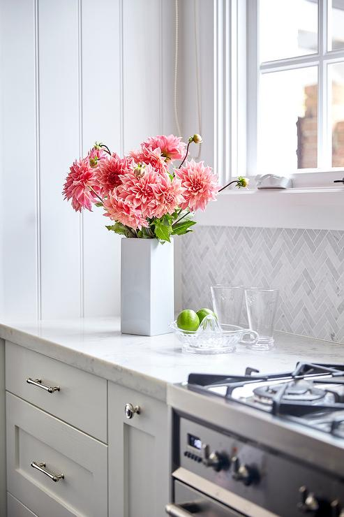 White Kitchen Cabinets With White Marble Chevron Tile Backsplash