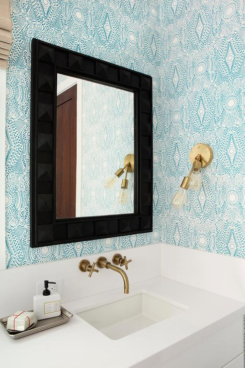 Gold and blue powder room with black prism mirror for Blue and gold bathroom ideas