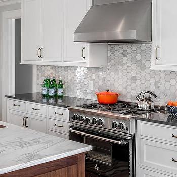 White Vent Hood With Black Range Transitional Kitchen