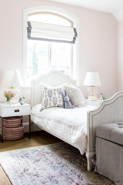 White French Cane Bed Below Arch Window Transitional
