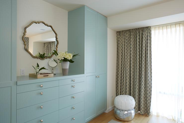 Great Chic Bedroom Features A 10 Drawer Blue Built In Dresser Adorned With Nickel  Knobs Placed Under A Mirror Flanked By Floor To Ceiling Blue Wardrobe  Cabinets.