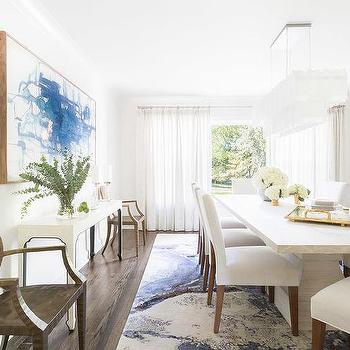 Alyssa Rosenheck: White Dining Room With Blue Abstract Art