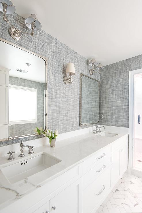 White And Tan Bathroom With Antiqued Mirrored Pendant