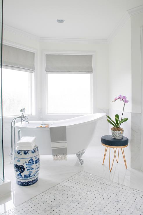 Waterworks Bathtub Flanked By Built In Shelves