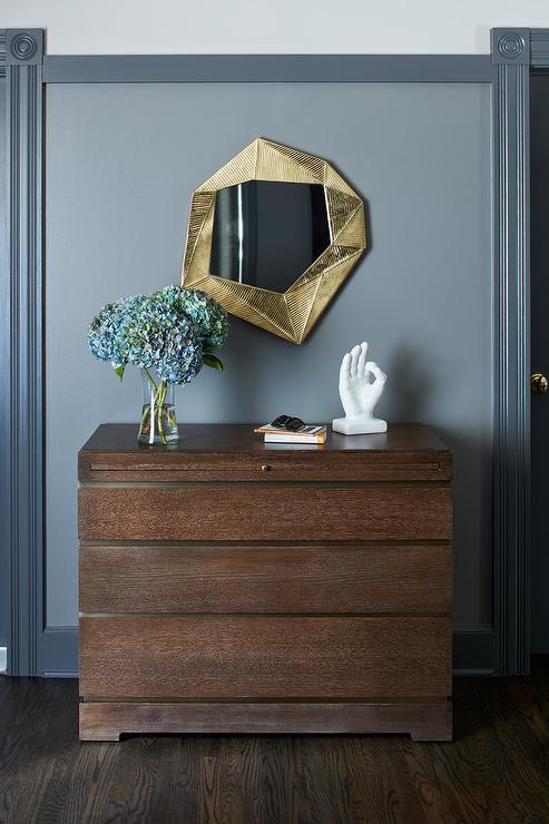 gold deco mirror with brown chest of drawers - contemporary - living