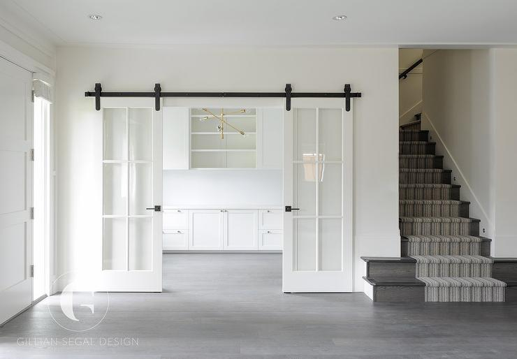 Attractive White Home Office With Glass Paned Sliding Doors On Rails