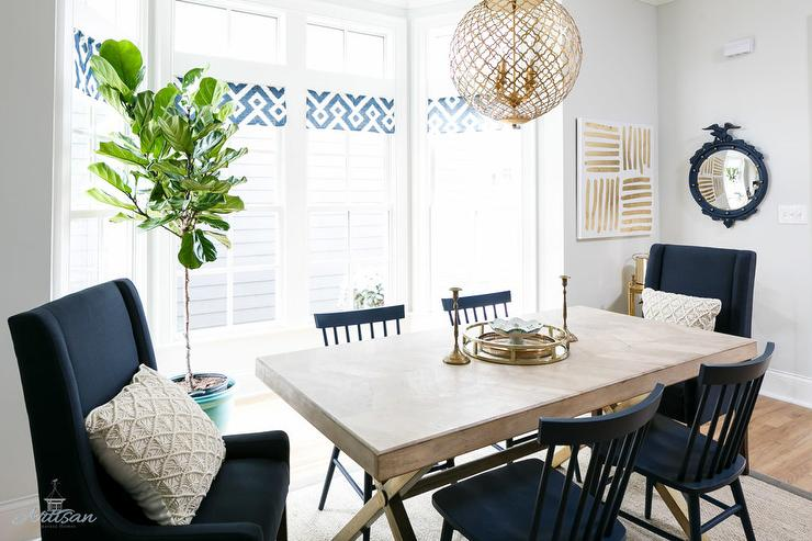 X Based Dining Table With Navy Blue Chairs