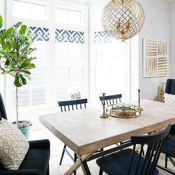 x based dining table with navy blue dining chairs