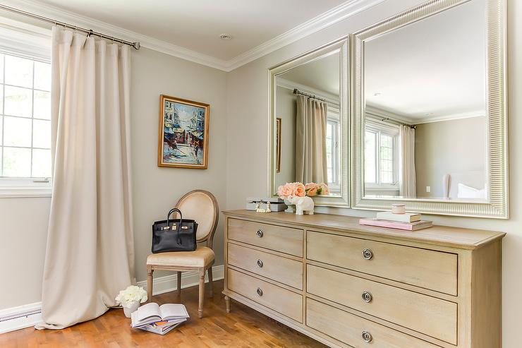 french bedroom boasts a gold velvet round back chair lined with a hermes birkin bag situated next to an antiqued gray 6 drawer dresser restoration hardware - Restoration Hardware Bedroom Furniture