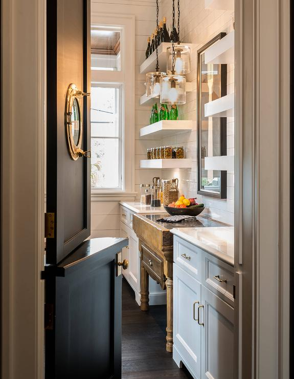 A Black Dutch Door Fitted With A Porthole Opens To A Gorgeous Cottage  Butleru0027s Pantry Equipped With An Antique Wood Island Placed Against Shiplap  Trim Below ...