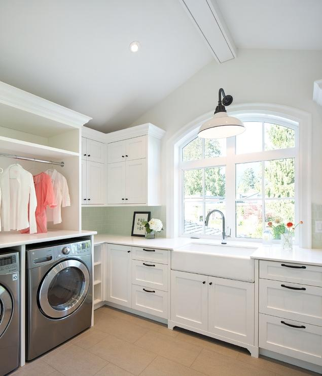 fantastic laundry room features white cabinets adorned with bronze hardware topped with white quartz countertops in caesarstone organic white fitted with a - White Countertops