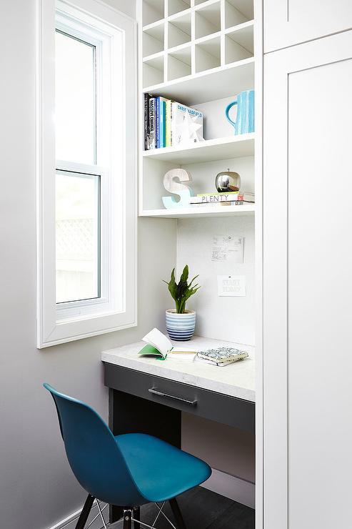 pigeon hole storage unit over charcoal gray lacquered desk. Black Bedroom Furniture Sets. Home Design Ideas