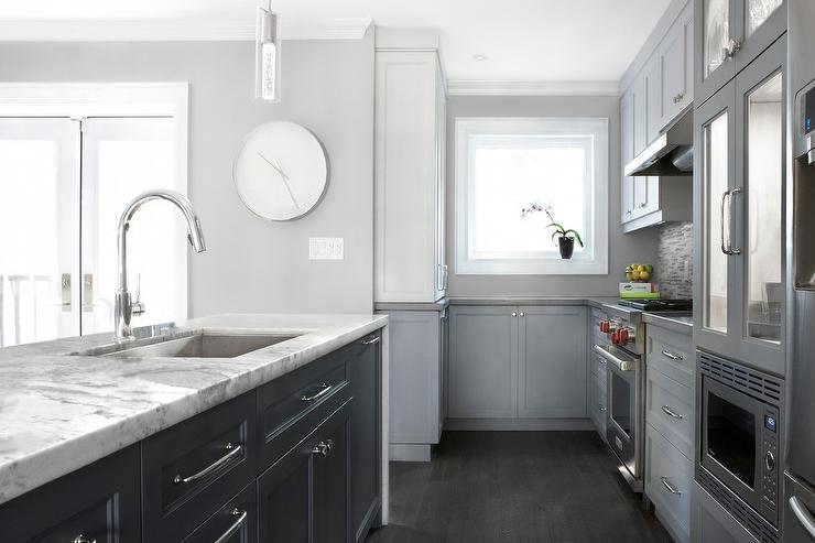 White kitchen with glossy gray linear backsplash tiles for Dark kitchen cabinets with light island