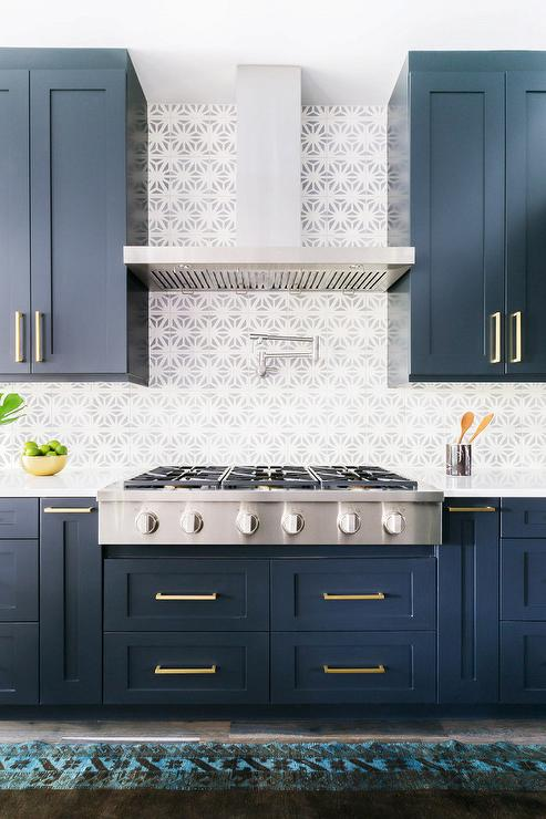 Alyssa rosenheck blue shaker kitchen cabinets with long for Dark blue kitchen units