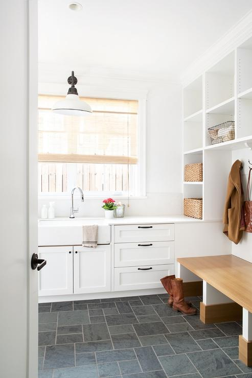fantastic mudroom and laundry room combo features stacked cubby