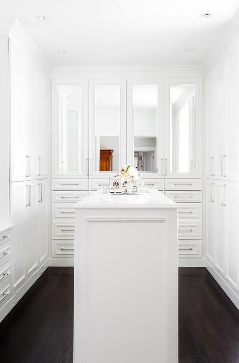 Closet With Mirrored Cabinet Doors
