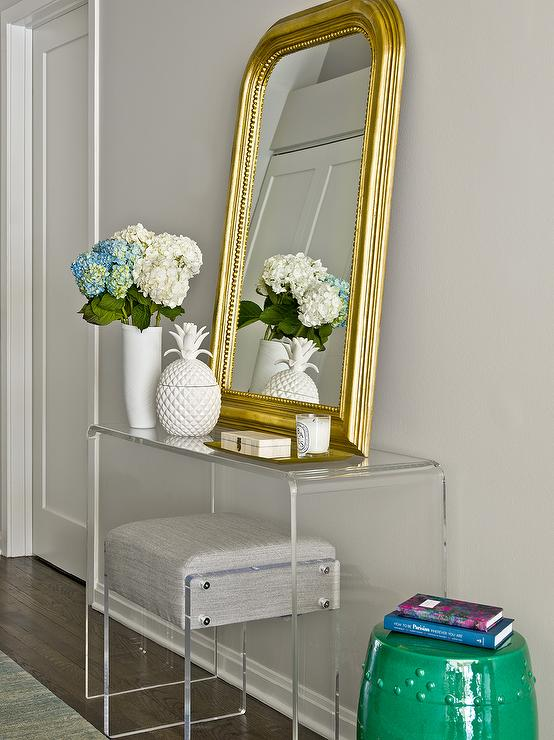 CB2 Peekaboo Acrylic Console Table With Gold Beaded Arch Mirror