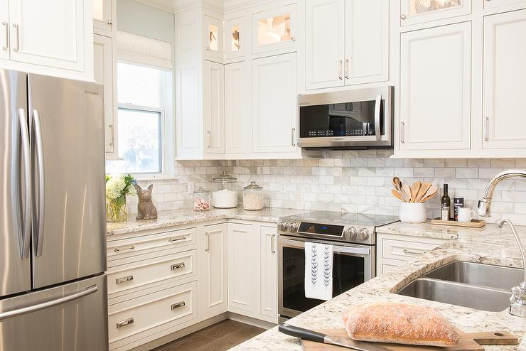 White Kitchen Cabinets With Gold And Gray Granite Countertops