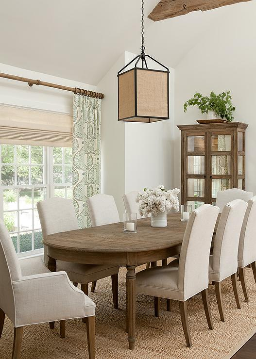 Oval French Dining Table With Light Gray Camelback Chairs